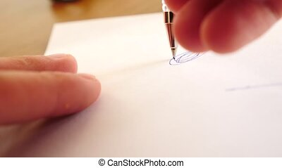 Extreme close up of ballpoint pen writing . 4k, slow motion.
