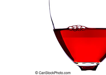 Extreme close-up of bubbles in red wine