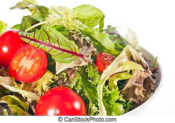 Extreme close up of fresh tomato and lettuce salad
