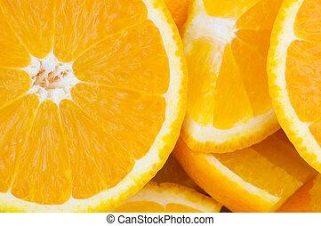 Extreme close up of half cut oranges