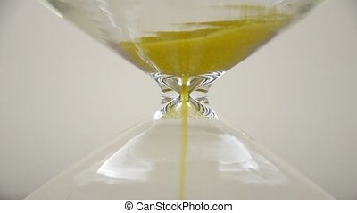 Extreme Close-up of Hourglass - Extreme close-up of sand...