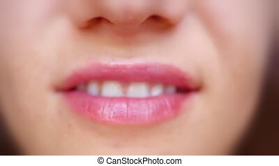 Extreme close up of lips and smiling with white teeth in slowmotion