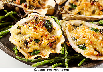 Extreme Close Up of Oysters with Cheesy Gratin Topping Served on Plate with Green Garnish on White Background