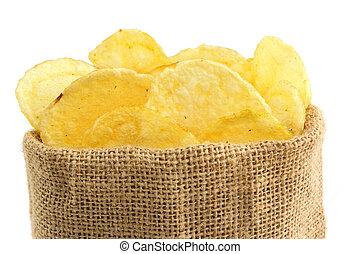 extreme close up of potato crisps in a jute bag