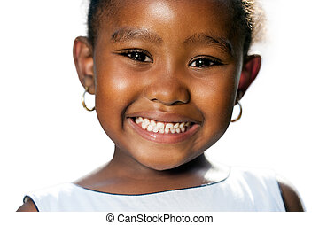 Extreme close up of small african girl showing teeth.T