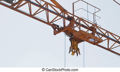 Extreme close-up of tower crane hoisting mechanism