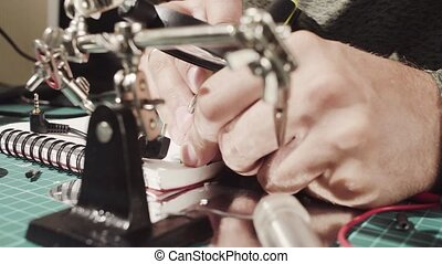 Male hands cutting wire - Extreme close up. Repairing of...