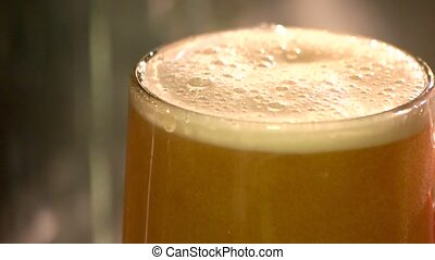 Extreme close up thick draft ale, slow-motion. Turbid ale...