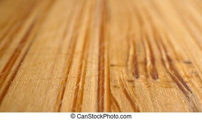 Extreme close-up, detailed. surface of a wooden cutting board with knife scratches.