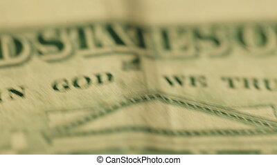 Extreme closeup dolly footage of US dollar banknotes.
