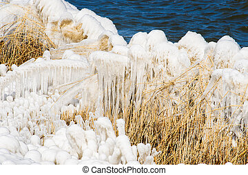 Extreme Ice Storm Hits Lake Shore. Thick ice coats the shore...
