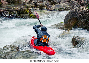 Extreme kayaking - Extreme riding in a canoe on rapid river
