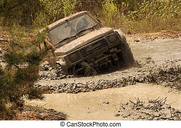 off-road - Extreme off-road. Roadster in the big mud