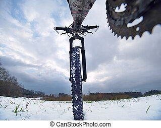 Extreme race in snow. Winter adventure and extreme cycling concept
