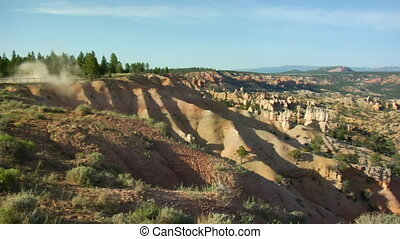 extreme red rock vistas panning to ATV trails
