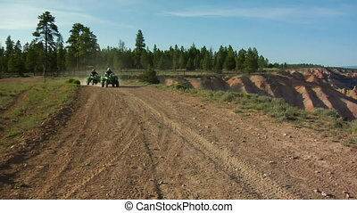 extreme red rock vistas panning to ATV trails