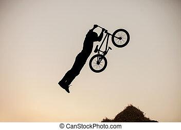 Extreme rider making a bike jump