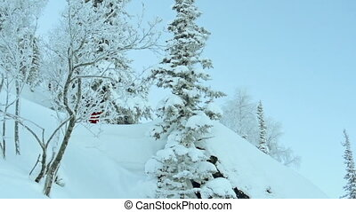 Extreme Skier - Tracking shot of big mountain skier...
