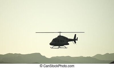 extreme slow motion flying helicopter and sunset sky