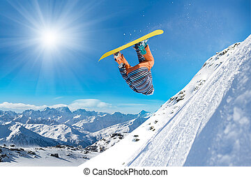 Extreme snowboarding man - Snowboarder jumping high in the ...