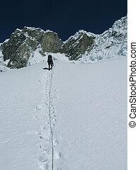 Extreme sport - Climber the climb on glacier