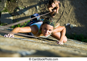 Extreme sport - Horizontal image of climber climbing up the...