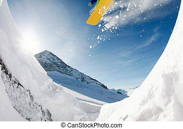 Extreme sport - Photo of jumping snowboarder over...
