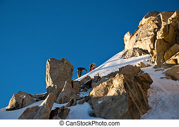 climber in the mountain - Extreme Sport. Young climber in...