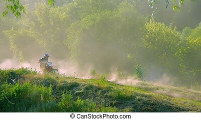 extreme sports motocross motorcycle jumping on a race on high speed rail amped through mud super slow motion racers fly over jump freestyle stunt