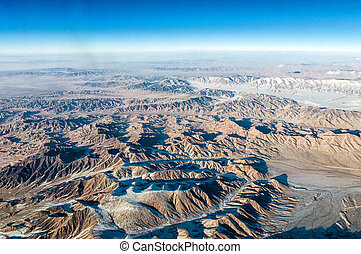 Extreme Terrain - aerial view of mountains and clouds on top