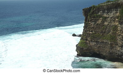 Extreme wave crushing coast Uluwatu in Bali Indonesia -...