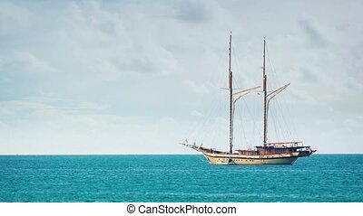 """Extreme Zoom of a Wooden Sailboat, Anchored on the Tropical..."