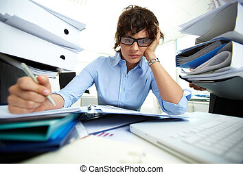 Extremely busy - Perplexed accountant doing financial...