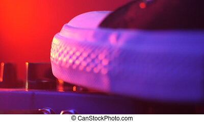Extremely close up of guitarist foot in sneakers pressing button for effect electro guitar pedal. Red neon light in night club during show concert . 4k