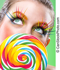 Extremely colorful lollipop, comes with matching makeup -...