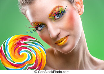 Extremely  colorful lollipop, comes with matching makeup