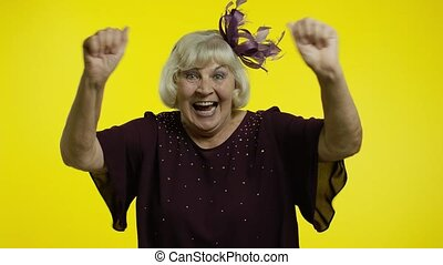 Extremely happy satisfied senior old woman with blond hair ...
