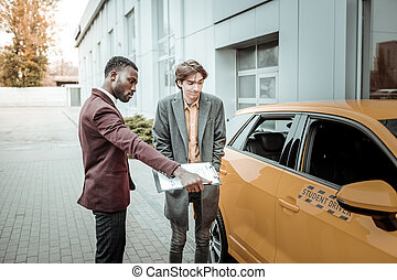Young man learning driving feeling extremely nervous