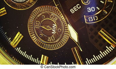 extremly close-up of gold watch timelapse