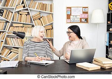 Exuberant senior woman and tutor reaching result - Great...