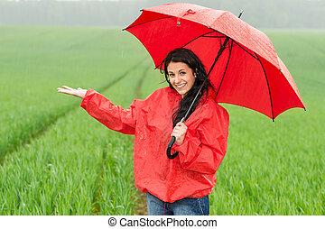 exulté, temps pluvieux, pendant, fille souriante