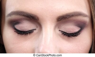 Eye bright makeup. Close up. Slow motion