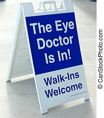 EYE DOCTOR SIGN - A blue and white sign announcing that the...