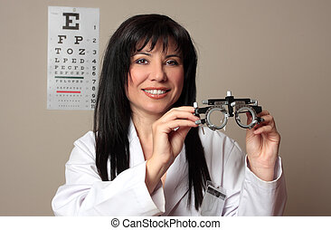 Eye doctor with trial frames - An eye doctor holding a pair...