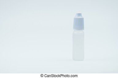 Eye drops bottle with white cap on white background with...