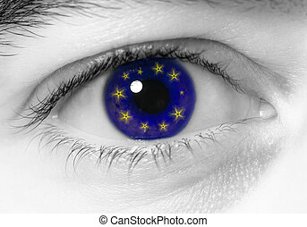 eye europe flag - black and white close up of eye with blue...