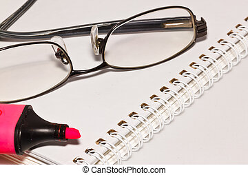 eye glass on note paper