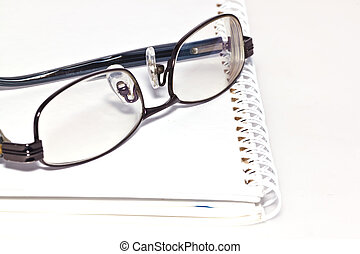 eye glass on paper