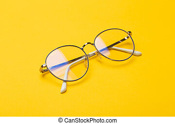 Eye glasses isolated on yellow background