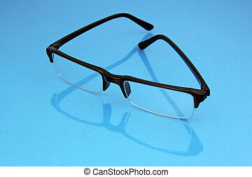 eye glasses on blue background